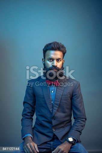 istock portrait young man posing with beard in suit 541122144