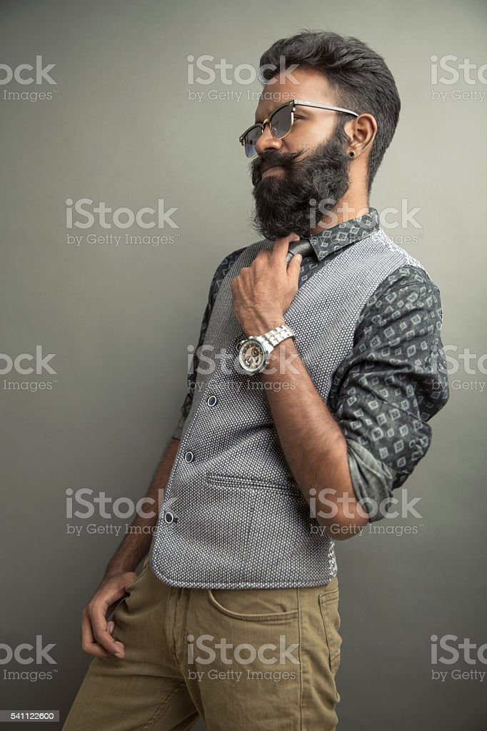 portrait young man posing with beard in suit with eye wear stock photo