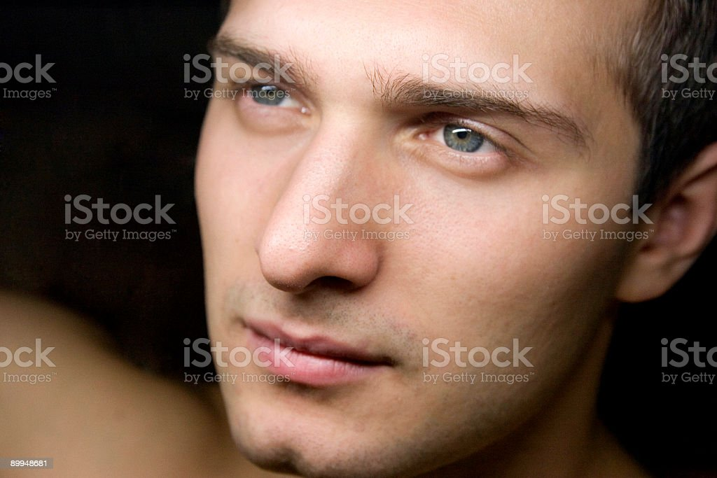 Portrait - young man with blue eyes stock photo