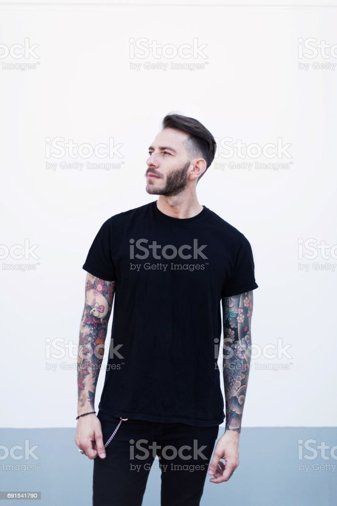 Portrait young man with dark cloth stock photo