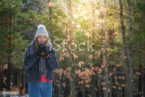 1051172208 istock photo portrait Young pretty woman in winter in the snow 924240282