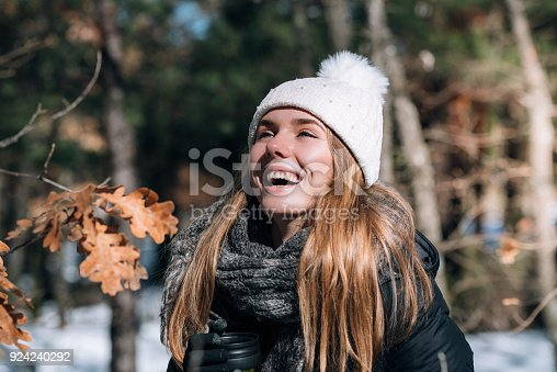 istock portrait Young pretty woman in winter in the snow 924240292