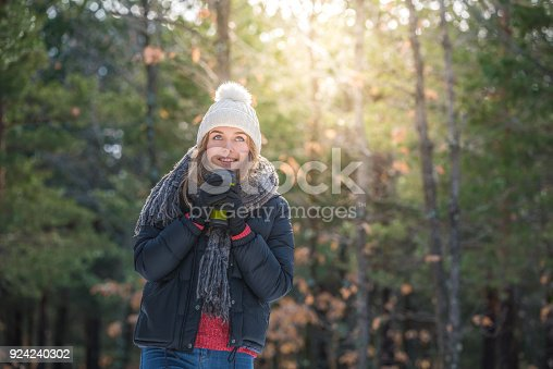 istock portrait Young pretty woman in winter in the snow 924240302