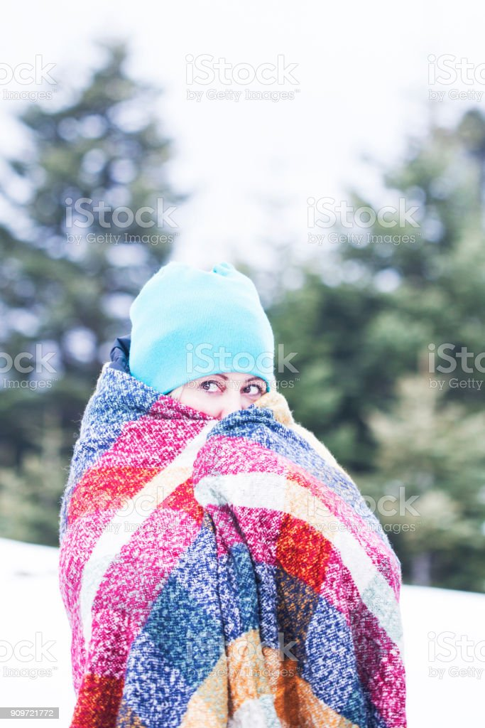 Portrait young woman warms her hands in cold winter stock photo