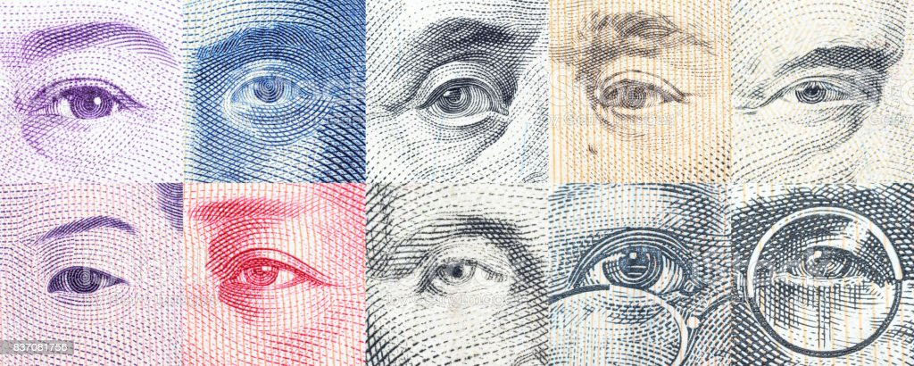 Portraits / images / the eyes of famous leader on banknotes. stock photo