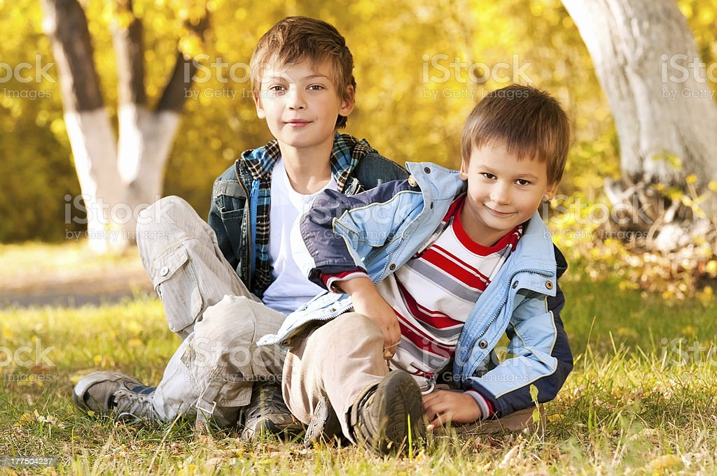 Portraits of the boys on grass royalty-free stock photo