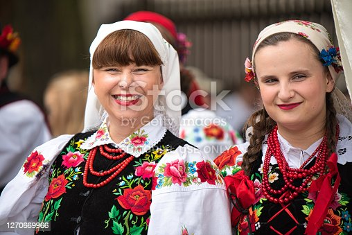 istock Portraits of women dressed in polish national folk costumes from Lowicz region during Corpus Christi procession. Polish culture 1270669966