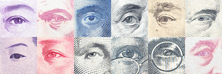 istock Portraits / the eyes of famous leader on banknotes. 589583216