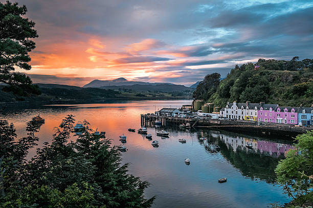 Portree Dawn Dawn breaks over the colourful harbour of Portree, Isle of Skye. isle of skye stock pictures, royalty-free photos & images