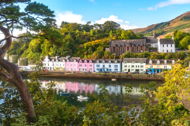 Portree Isle of Skye morning amazing view flowers colored houses llake bay amazing view flowers colored houses llake bay isle of skye stock pictures, royalty-free photos & images