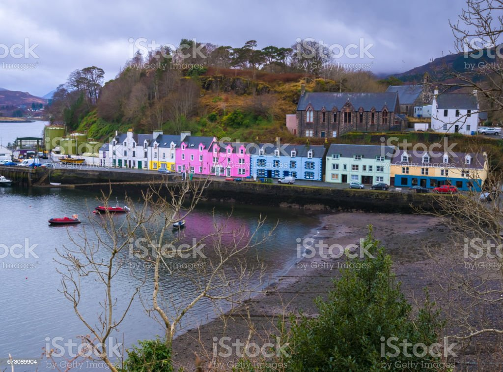 Portree, the largest town on Skye in the Inner Hebrides of Scotland. It has a quaint harbour, fringed by cliffs. stock photo