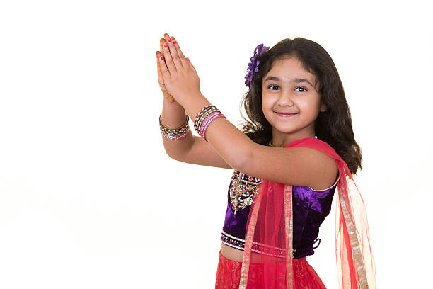 Portriat of a Little Girl in Indian Dance Pose stock photo