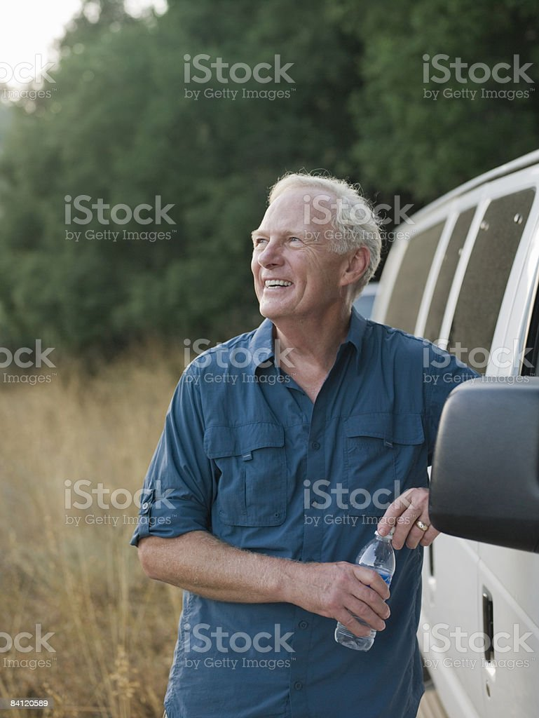 Portrit of smiling man next to a van royalty-free stock photo
