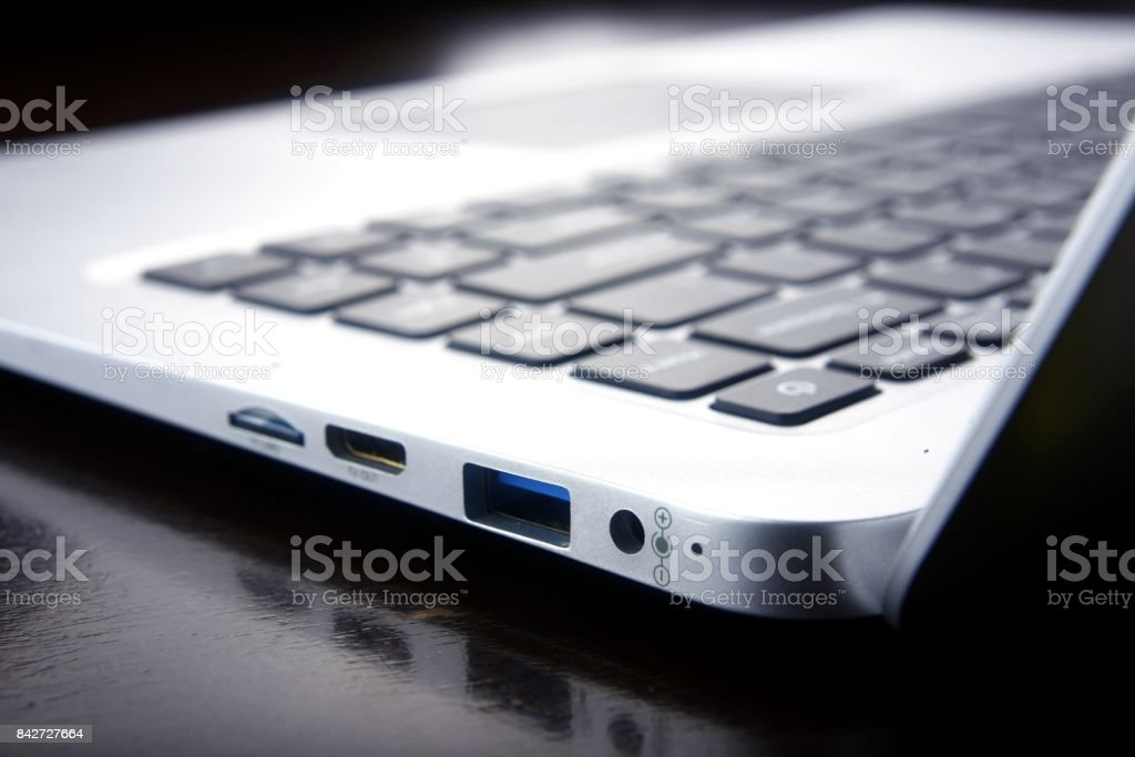 Ports and connections of a laptop computer. stock photo