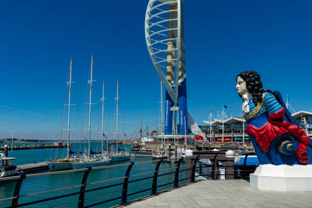 Portsmouth, Hampshire, England Portsmouth Hampshire England July 23, 2018 Spinnaker Tower with the HMS Marlborough figurehead in the foreground naval base stock pictures, royalty-free photos & images