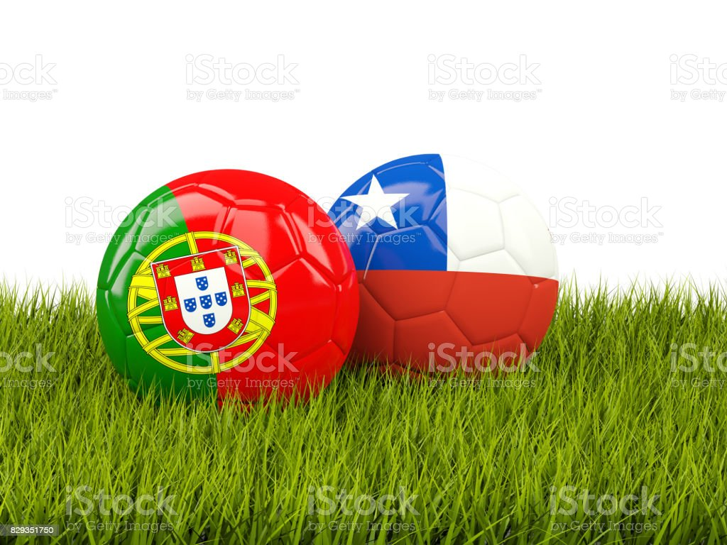 Portugal and Chile soccer balls on grass stock photo