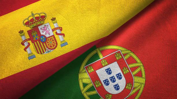portugal en spanje twee vlaggen samen realations textiel doek stof textuur - portugal stockfoto's en -beelden