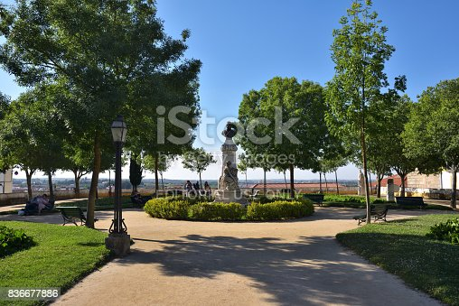 Evora, Portugal - June 2, 2017: The Diana Garden and sculpture of the doctor Barahona in Evora. Popular tourist destination in central Portugal