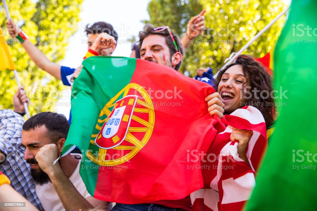Portugal fans watching and supporting their team at world competition football league stock photo