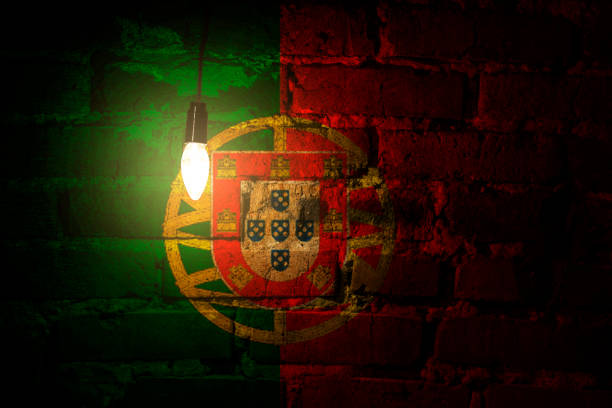 portugal flag on a brick wall lit by a lamp - ronaldo imagens e fotografias de stock