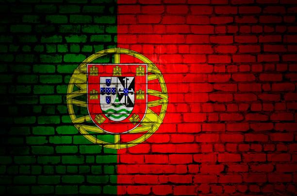 portugal flag on a brick wall - ronaldo imagens e fotografias de stock