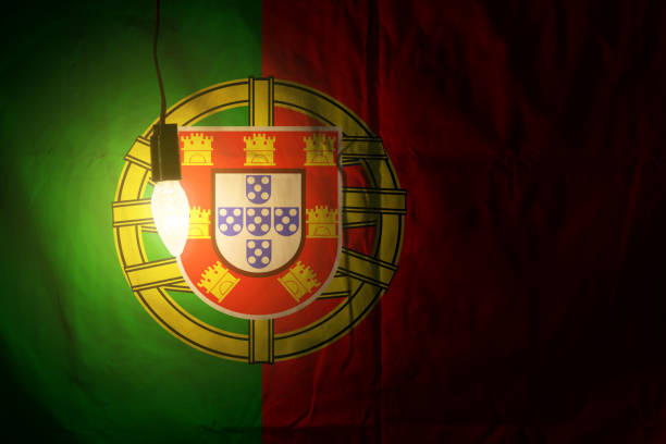 portugal flag on the wall illuminated by lamp - ronaldo imagens e fotografias de stock