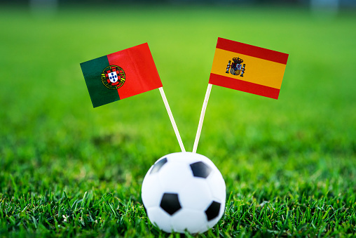 Portugal - Spain, Group B, Friday, 15. June, Football, World Cup, Russia 2018, National Flags on green grass, white football ball on ground.
