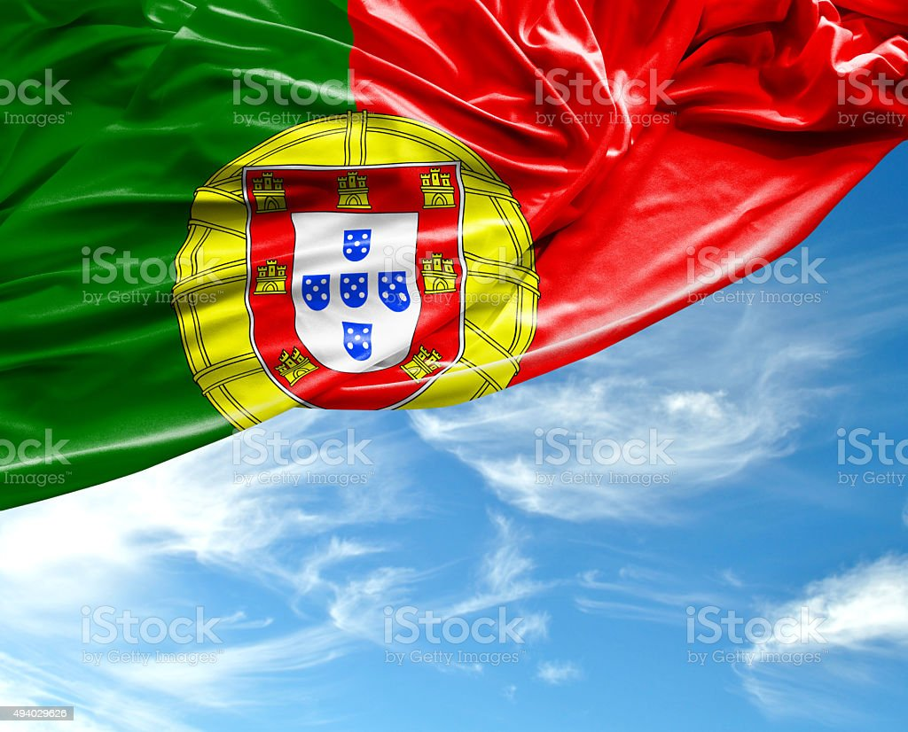 Portugal waving flag on beautiful day stock photo