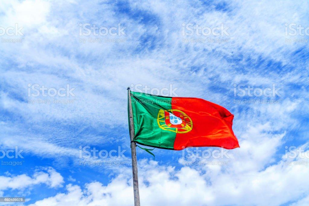 Portugese flag against blue sky - fotografia de stock
