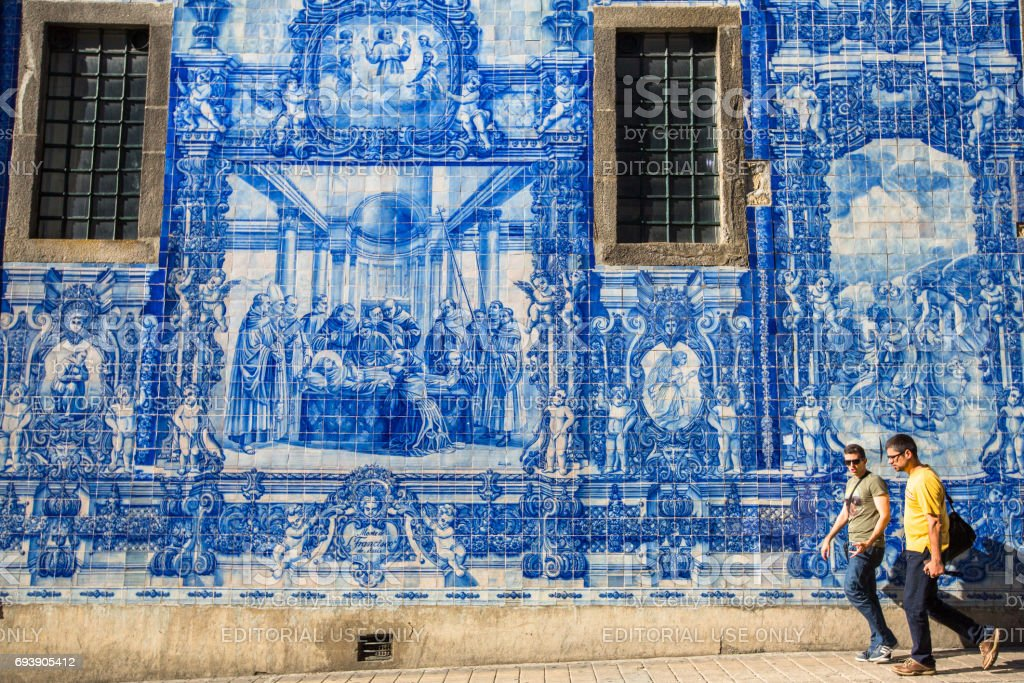 PORTO, PORTUGAL - MAY 7, 2017:  Portuguese azulejo tile on one of the streets of the Old Town. In 1996, UNESCO recognised Old Town of Porto as a World Heritage Site. stock photo