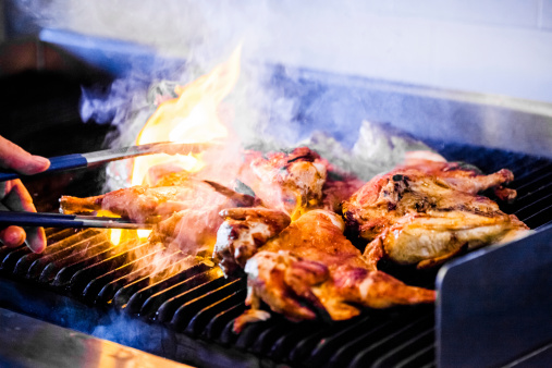 Portuguese Chicken On The Grill Stock Photo - Download Image Now