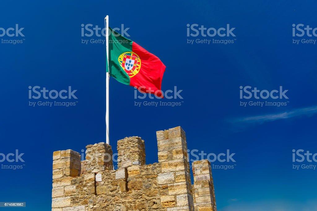 Portuguese flag on fortress wall, Lisbon, Portugal - fotografia de stock