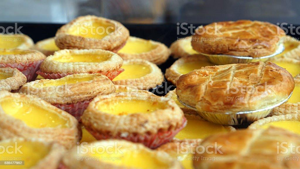 Portuguese Hong Kong style dessert egg and pineapple tarts stock photo