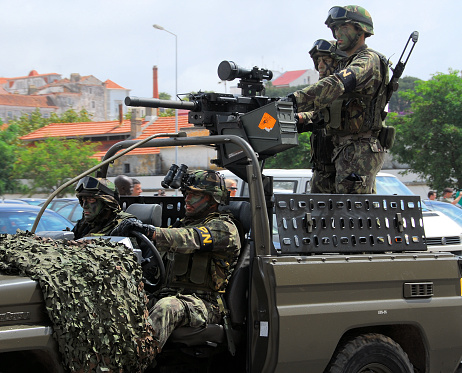 Portuguese Marines vehicle with Heckler & Koch GMG automatic grenade launcher - downtown, Setubal, Portugal