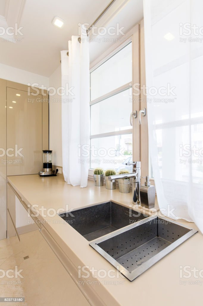 Posh kitchen bathed in morning sunlight stock photo