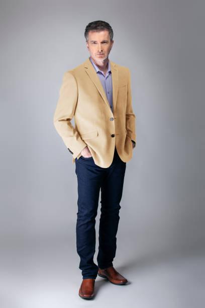 Posh Middle Aged Man Wearing Beige Jacket stock photo