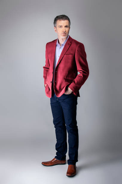 Posh Middle Aged Man Wearing Maroon or Red Jacket stock photo