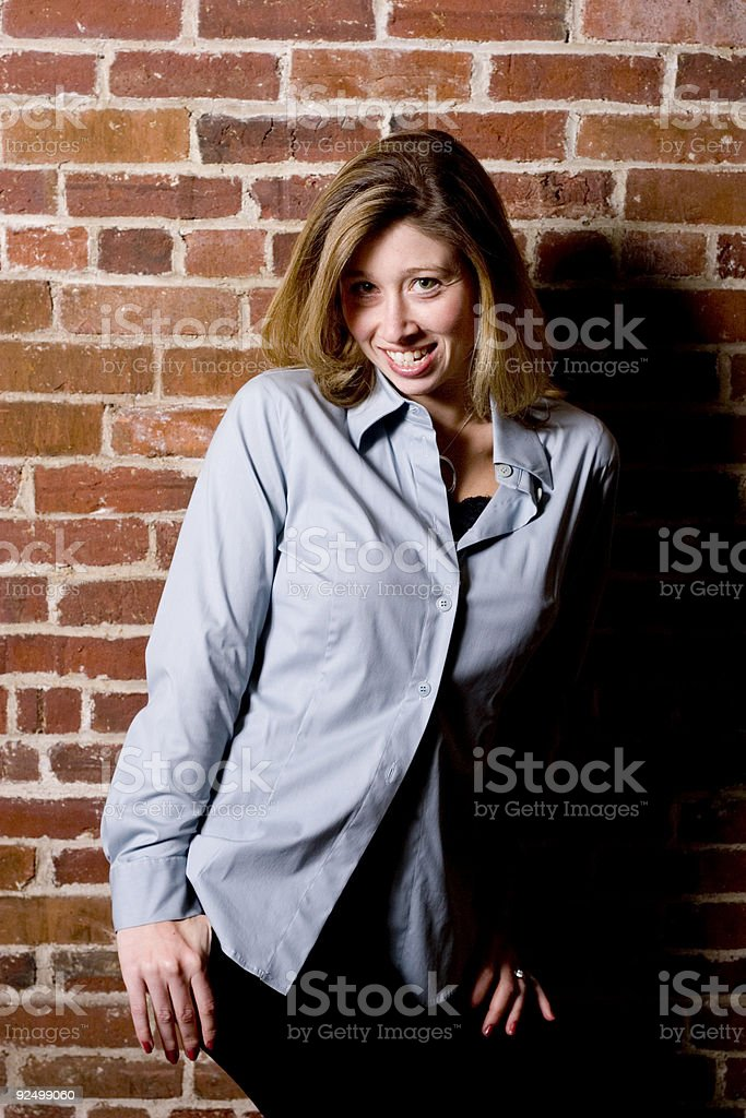 Posing against wall royalty-free stock photo