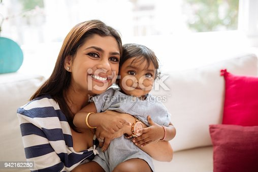 istock Posing for Photography with Little Daughter 942162280