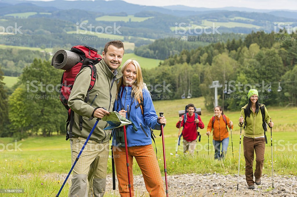 Posing hiker couple with landscape background royalty-free stock photo