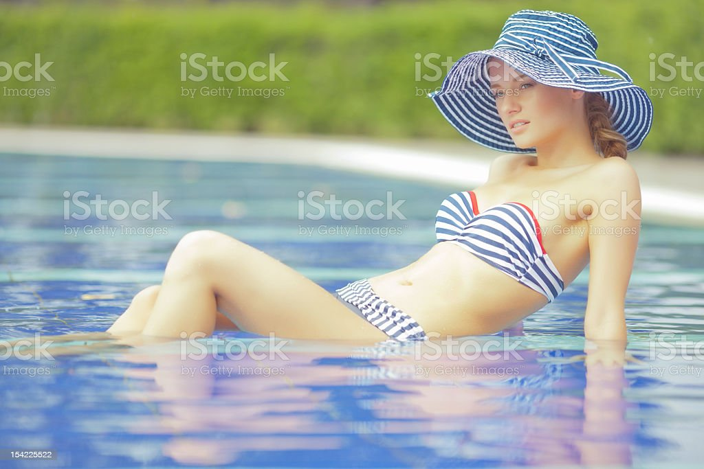 Posing in a pool royalty-free stock photo