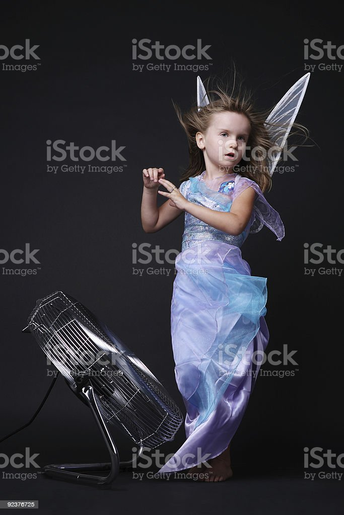 Posing in strong stream of air. royalty-free stock photo