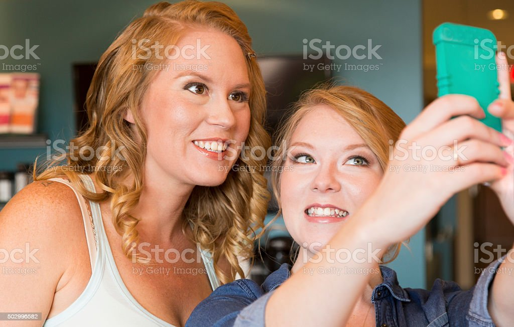 Posing Sisters stock photo