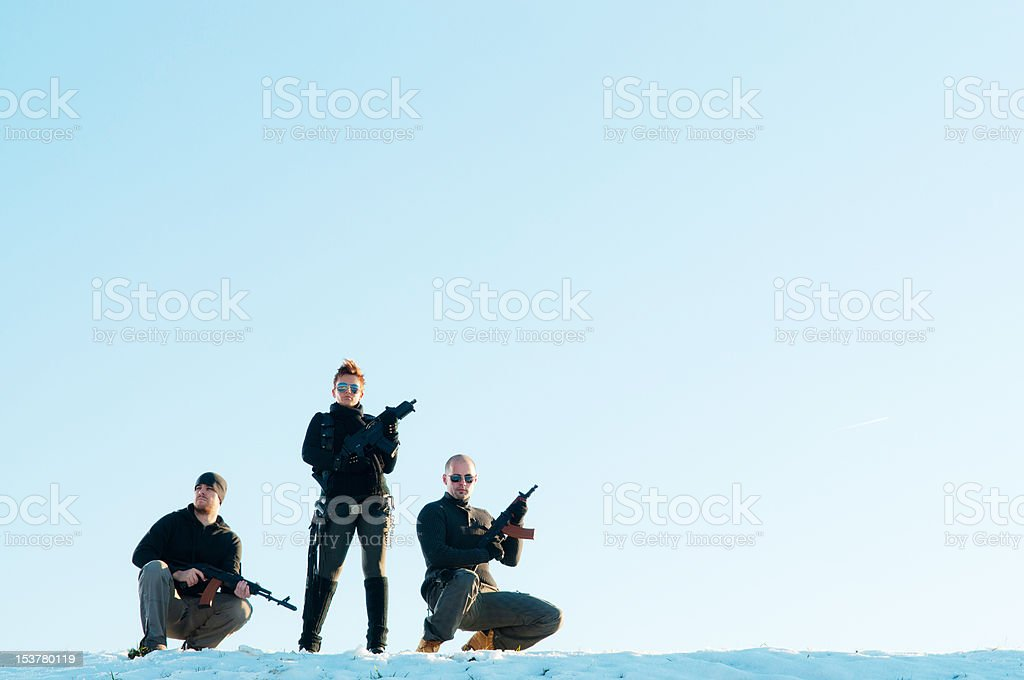 Posing with guns royalty-free stock photo