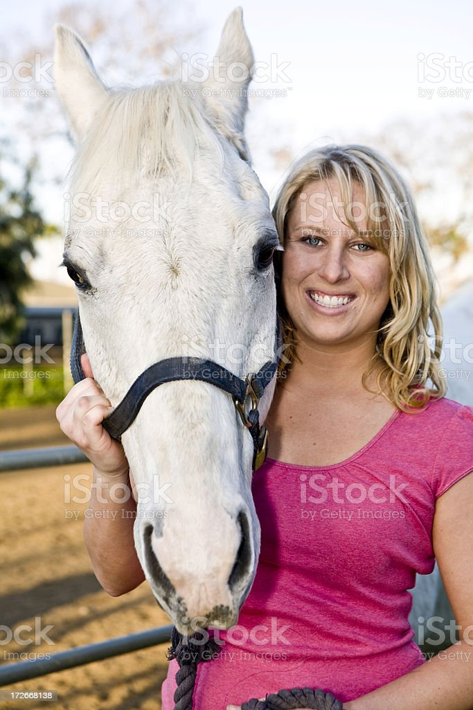 Posing With Her Horse royalty-free stock photo