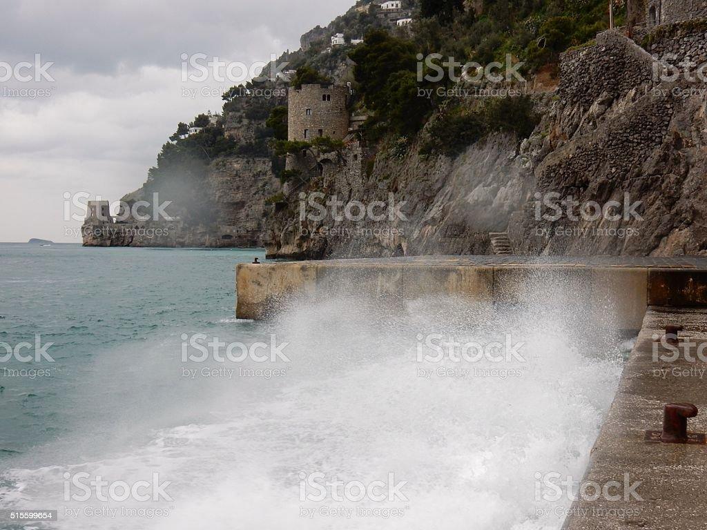 Positano - Molo sferzato dalle onde stock photo