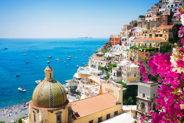 Positano resort, Italy view of Positano with flowers - famous old italian resort, Italy mediterranean sea stock pictures, royalty-free photos & images