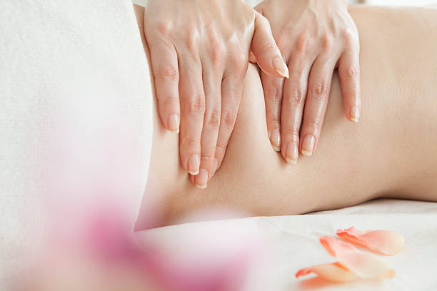 Position of hands and fingers at massage of female body stock photo