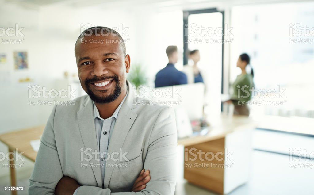 Positive and professional, everything you'd want in a great manager stock photo