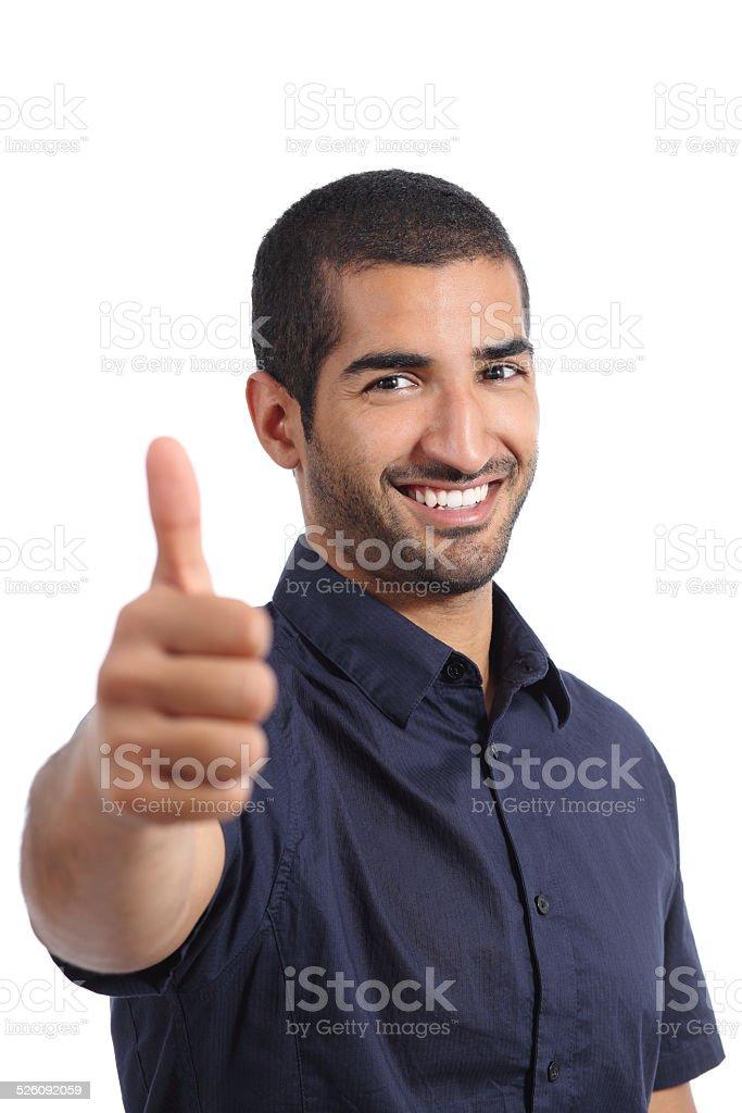 Positive arab man gesturing thumbs up stock photo